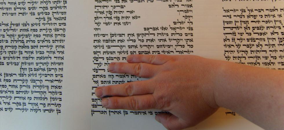 Hand on scroll