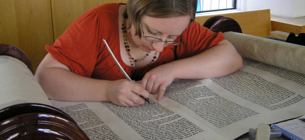 A scribe repairs a torah