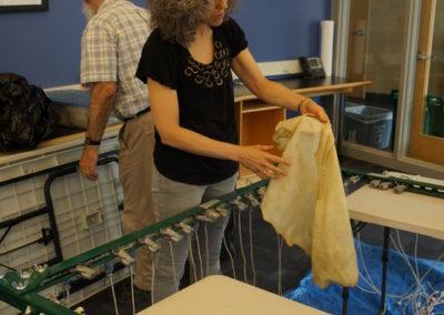 Rabbi Linda Motzkin making parchment
