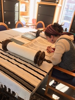 Laura Bellows at work repairing a Torah scroll